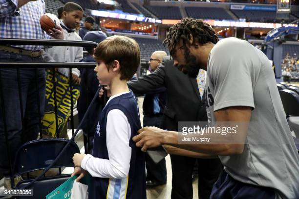 Mike Conley of the Memphis Grizzlies signs autographs for fans before the game against the Sacramento Kings on April 6 2018 at FedExForum in Memphis...