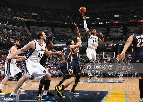 Mike Conley of the Memphis Grizzlies takes a shot against the Indiana Pacers on March 22 2014 at FedExForum in Memphis Tennessee NOTE TO USER User...