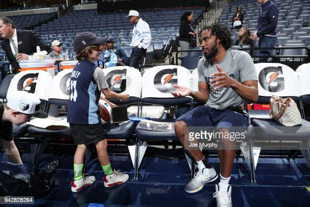 Mike Conley of the Memphis Grizzlies talks with a fan before the game against the Sacramento Kings on April 6 2018 at FedExForum in Memphis Tennessee...