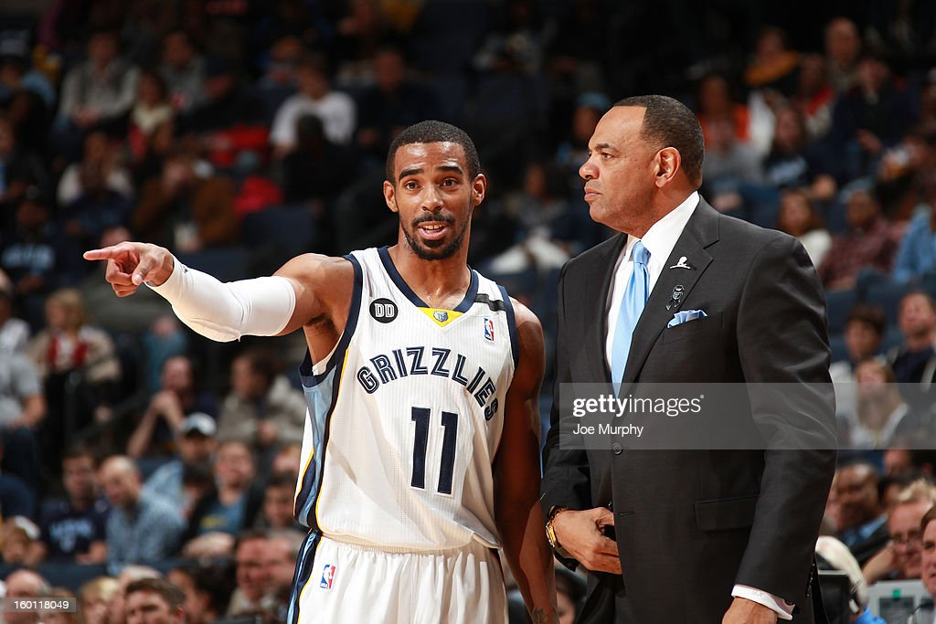 Mike Conley #11 of the Memphis Grizzlies talks with Head Coach, Lionel Hollins, during a break in play against the Los Angeles Clippers on January 14, 2013 at FedExForum in Memphis, Tennessee.