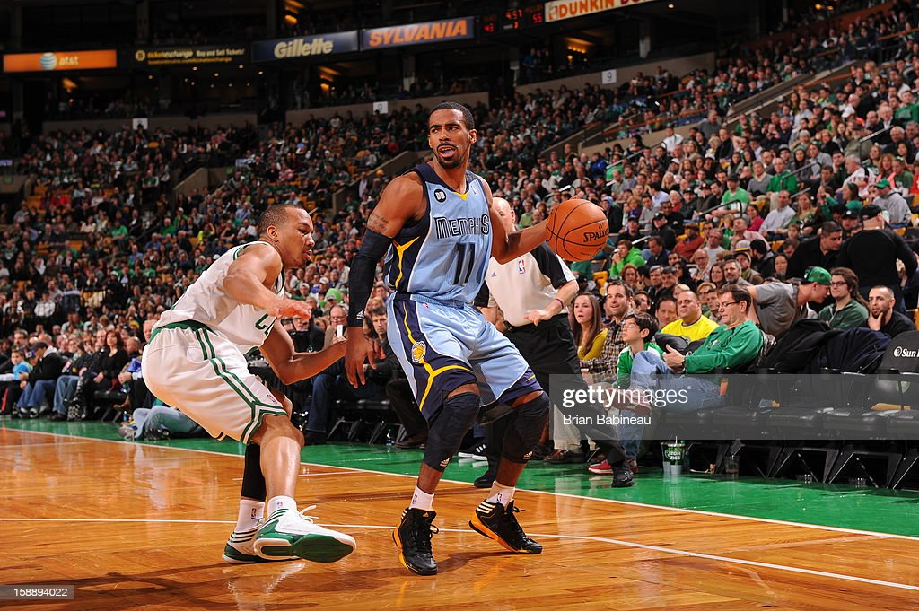 Mike Conley #11 of the Memphis Grizzlieslooks to pass the ball downlow against the Boston Celtics on January 2, 2013 at the TD Garden in Boston, Massachusetts.