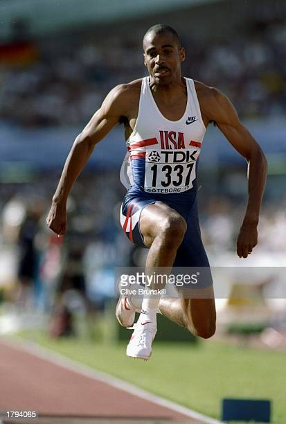 Mike Conley of the United States sails through the air in a triple jump event during the World Championships in Gothenburg Sweden Conley placed...