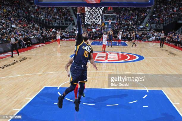 Mike Conley of the Utah Jazz drives to the basket during the game against the Denver Nuggets on March 7 2020 at Little Caesars Arena in Detroit...