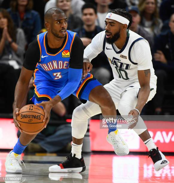 Mike Conley of the Utah Jazz guards Chris Paul of the Oklahoma City Thunder during an opening night game at Vivint Smart Home Arena on October 23...