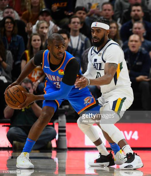 Mike Conley of the Utah Jazz guards Chris Paul of the Oklahoma City Thunder during an opening night game at Vivint Smart Home Arena on October 23,...