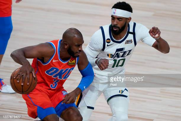 Mike Conley of the Utah Jazz guards Chris Paul of the Oklahoma City Thunder during the first half of an NBA basketball game on August 1 in Lake Buena...