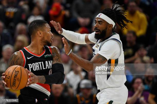 Mike Conley of the Utah Jazz guards Damian Lillard of the Portland Trail Blazers at Vivint Smart Home Arena on October 16 2019 in Salt Lake City Utah...