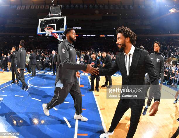 Mike Conley the Memphis Grizzlies greets teammates against the New York Knicks at Madison Square Garden on December 6 2017 in New YorkNew York NOTE...