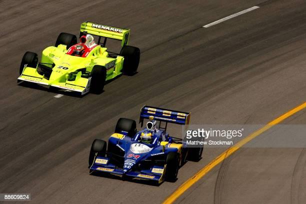 Mike Conway driver of the Dad's Root Beer Dreyer Reinbold Dallara Honda leads Ed Carpenter driver Menards Vision Racing Dalara Honda during the IRL...