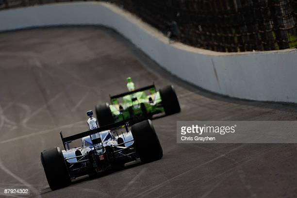 Mike Conway drives the Dreyer Reinbold Racing Dallara Honda behind Nelson Philippe in the i drive green HVM Racing Dallara Honda during Miller Lite...