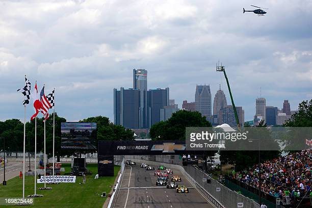 Mike Conway of England driver of the Dale Coyne Racing Honda leads a pack of cars at the start of the IZOD IndyCar Series Chevrolet Indy Dual in...