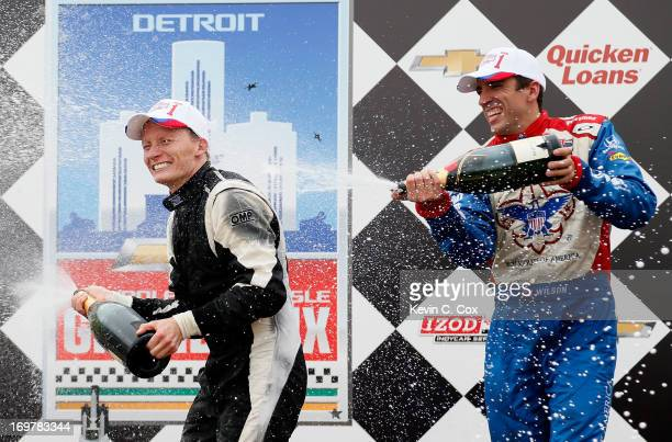 Mike Conway of England driver of the Dale Coyne Racing Honda celebrates winning the IZOD IndyCar Series Chevrolet Indy Dual in Detroit at the Raceway...