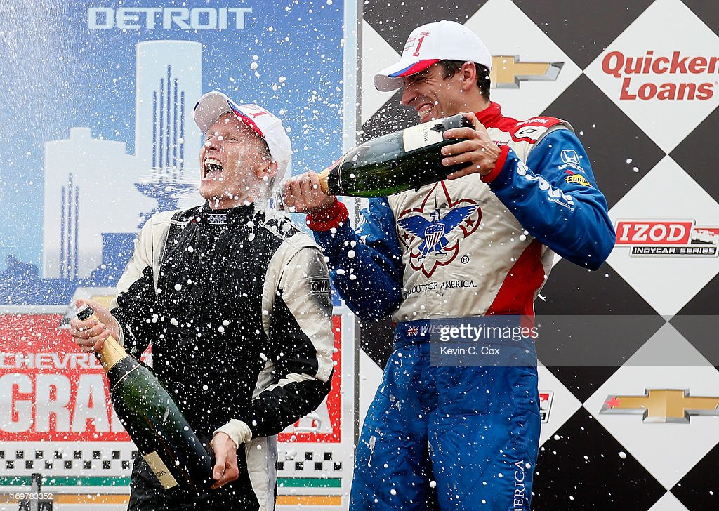 Mike Conway of England, driver of the #18 Dale Coyne Racing Honda, celebrates winning the IZOD IndyCar Series Chevrolet Indy Dual in Detroit at the Raceway at Belle Isle Park with third-place finisher and teammate Justin Wilson of England, driver of the #19 Dale Coyne Racing Honda, on June 1, 2013 in Detroit, Michigan.