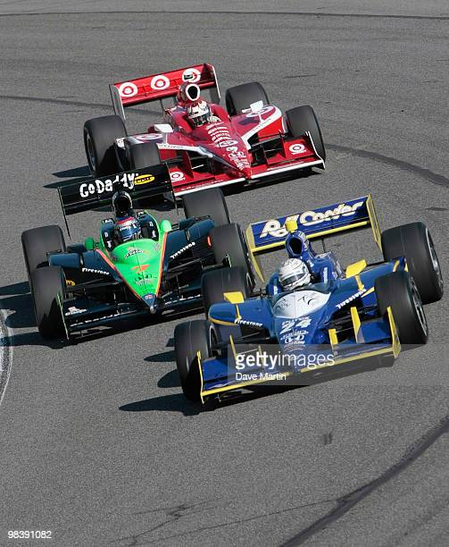 Mike Conway of England driver of the Dreyer and Reinbold Racing Dallara Honda leads Danica Patrick driver of the Team GoDaddycom Dallara Honda and...