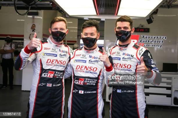 Mike Conway of Great Britain and Toyota Gazoo Racing, Kamui Kobayashi of Japan and Toyota Gazoo Racing, and Jose Maria Lopez celebrate pole position...