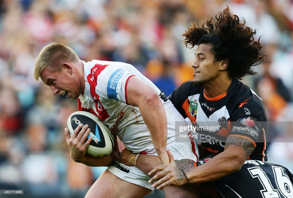 Mike Cooper of the Dragons is tackled during the round 20 NRL match between the Wests Tigers and the St George Illawarra Dragons at ANZ Stadium on July 27, 2014 in Sydney, Australia.