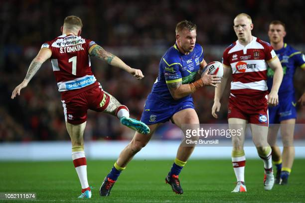 Mike Cooper of the Warrington Wolves moves away from Sam Tomkins of the Wigan Warriors during the BetFred Super League Grand Final between Warrington...