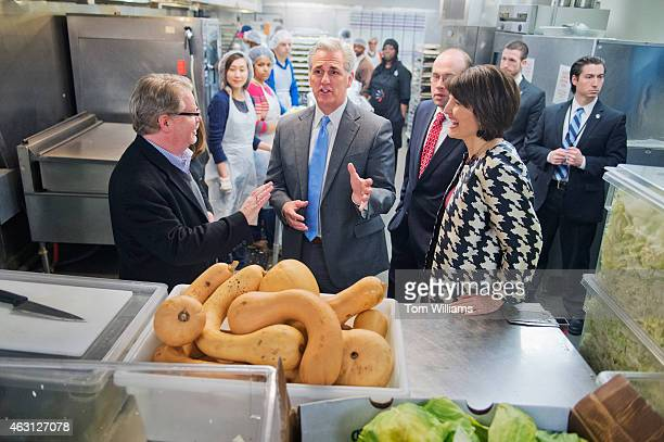 Mike Curtin left CEO of DC Central Kitchen gives a tour of the facility to House Majority Leader Kevin McCarthy RCalif Rep Jason Smith RMo and...