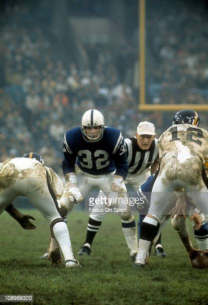 Mike Curtis of the Baltimore Colts is down and ready for action against the Pittsburgh Steelers during an NFL football game at Memorial Stadium...