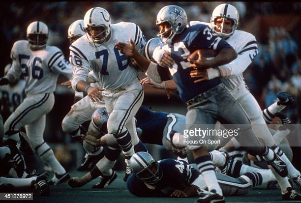 Mike Curtis of the Baltimore Colts wraps up Duane Thomas of the Dallas Cowboys during Super Bowl V on January 17 1971 at the Orange Bowl in Miami...