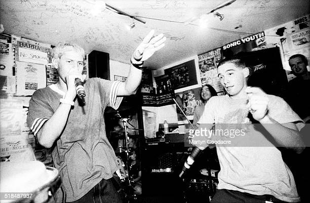 Mike D and Money Mark of the Beastie Boys perform at a secret gig in the basement of Slam City Skates shop Covent Garden London United Kingdom 1994