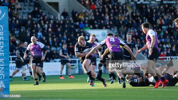 Mike Daniels of Newcastle Falcons charges towards the try line to score during the Greene King IPA Championship match between Newcastle Falcons and...