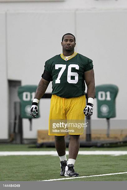 Mike Daniels of the Green Bay Packers talks to the coaches on the sidelines during mini camp at the Don Hutson Center on May 11 2012 in Green Bay...