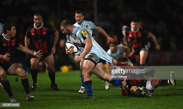 Mike Daniels of Worcester is pulled back by Henry Trinder of Gloucester during the European Rugby Challenge Cup match between Worcester Warriors and...