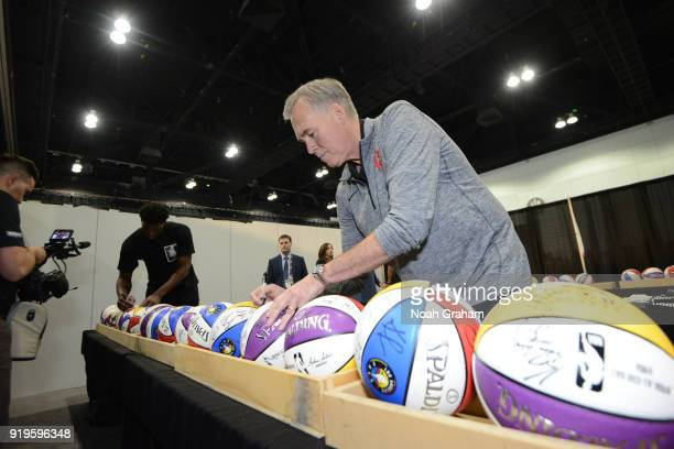Mike D'Antoni head coach of Team Stephen signs autographs before the 2018 NBA All Star Practice as part of 2018 AllStar Weekend at Verizon Up Arena...