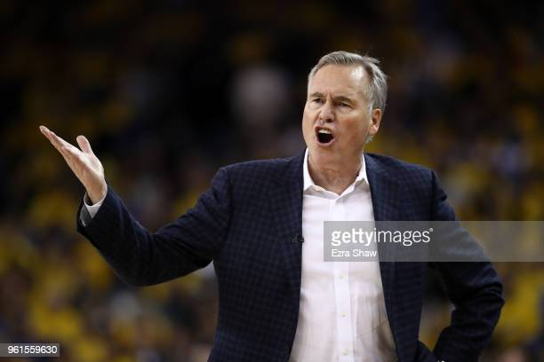 Mike D'Antoni of the Houston Rockets reacts to a play during Game Four of the Western Conference Finals of the 2018 NBA Playoffs against the Golden...