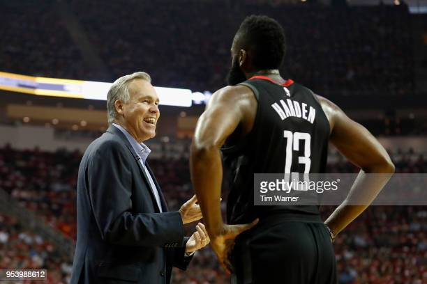 Mike D'Antoni of the Houston Rockets talks with James Harden in the first half during Game Two of the Western Conference Semifinals of the 2018 NBA...