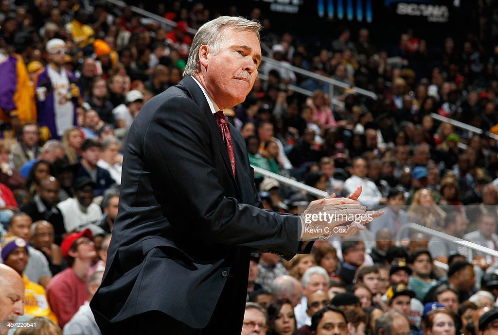 Mike D'Antoni of the Los Angeles Lakers yells to his team against the Atlanta Hawks at Philips Arena on December 16, 2013 in Atlanta, Georgia.