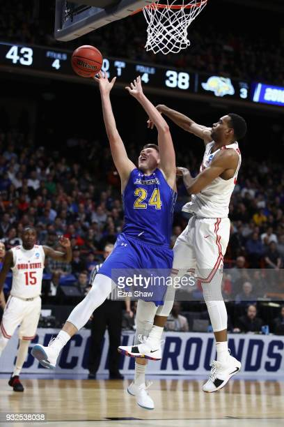Mike Daum of the South Dakota State Jackrabbits drives to the basket against Keita BatesDiop of the Ohio State Buckeyes in the first half during the...