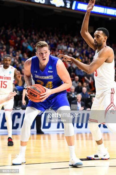Mike Daum of the South Dakota State University is guarded by Keita BatesDiop of the Ohio State University during the First Round of the 2018 NCAA...