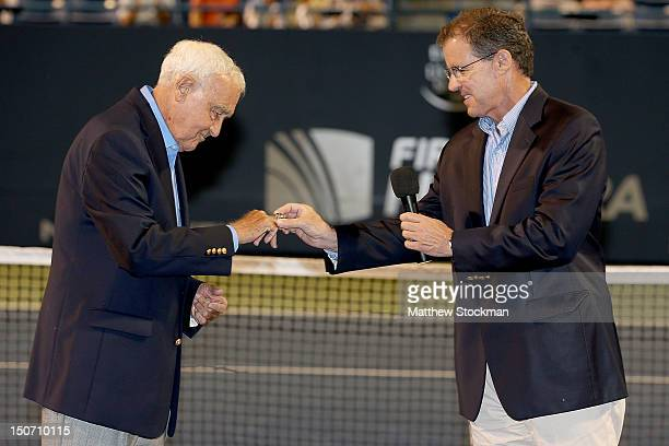 Mike Davies is presented a ring by Mark Stenning CEO of the International Tennis Hall of Fame commemorating his induction into the International...