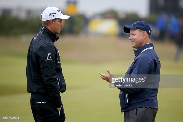 Mike Davis, Executive Director of the USGA in discussion with Henrik Stenson of Sweden during practice ahead of the 144th Open Championship at The...