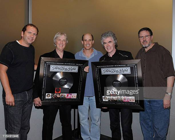 Mike Davis, General Manager of UME, Cory Wells of Three Dog Night, Bruce Resnikoff, UME President/CEO, Danny Hutton of Three Dog Night, and Andy...