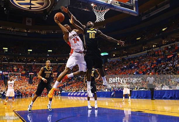 Mike Davis of the Illinois Fighting Illini drives to the basket against Ricardo Ratliffe of the Missouri Tigers during the Busch Braggin' Rights game...