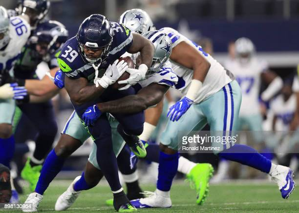 Mike Davis of the Seattle Seahawks is hit by Benson Mayowa of the Dallas Cowboys in the second quarter of a footbal game at AT&T Stadium on December...