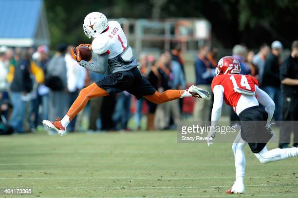 Mike Davis of the South team catches a pass in front of Aaron Colvin during a Senior Bowl practice session at Fairhope Stadium on January 20 2014 in...