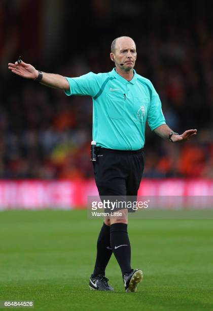 Mike Dean gestures during the Premier League match between AFC Bournemouth and Swansea City at Vitality Stadium on March 18 2017 in Bournemouth...