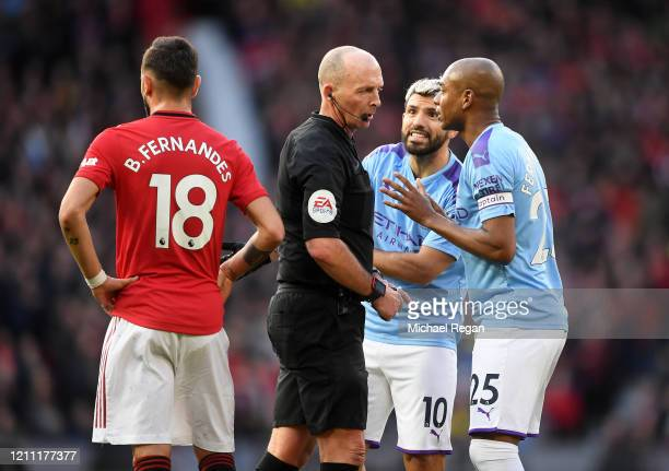 Mike Dean Match Referee speaks with Fernandinho of Manchester City and Sergio Aguero of Manchester City as Bruno Fernandes of Manchester United looks...