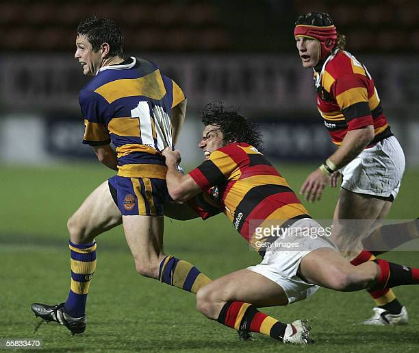 Mike Delany of Bay of Plenty is tackled by Bryon Kelleher of Waikato during the NPC Rugby match between Waikato and Bay of Plenty at Rugby Park...