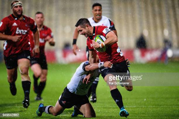 Mike Delany of the Crusaders is tackled during the round 10 Super Rugby match between the Crusaders and the Sunwolves at AMI Stadium on April 21 2018...