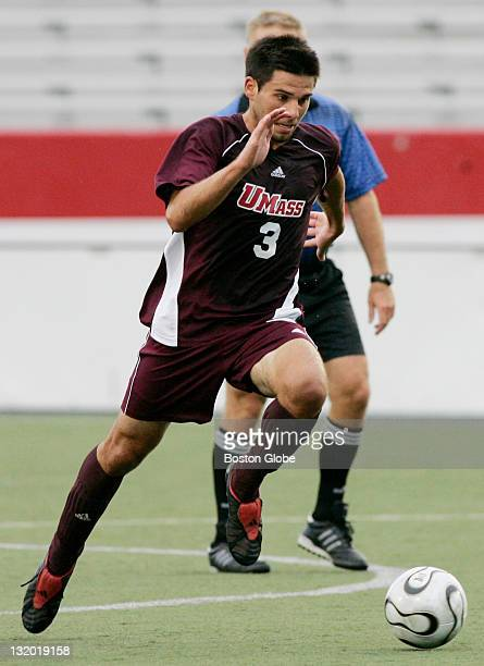 Mike DeSantis, #3, plays soccer for UMass Amherst as his brother Mark DeSantis, #18, not pictured, watches from the sideline during a game against...