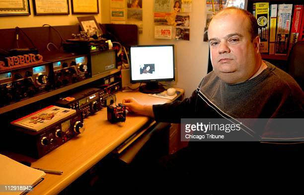 Mike Dinelli sits in the basement of his home in Skokie Illinois with his shortwave ham radio setup Saturday January 21 2006 Dinelli has been...