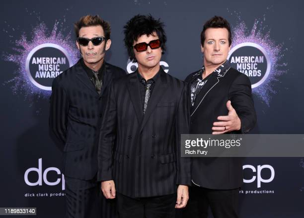 Mike Dirnt Billie Joe Armstrong and Tré Cool of Green Day attend the 2019 American Music Awards at Microsoft Theater on November 24 2019 in Los...