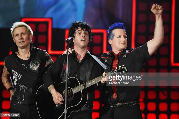 Mike Dirnt Billie Joe Armstrong and Tre Cool of Green Day perform onstage during Global Citizen Festival 2017 at Central Park on September 23 2017 in...