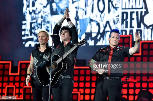 Mike Dirnt Billie Joe Armstrong and Tre Cool of Green Day perform onstage during the 2017 Global Citizen Festival For Freedom For Justice For All in...