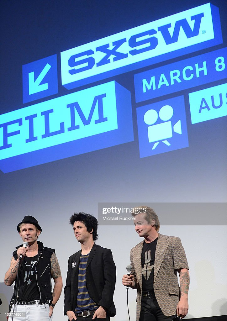 Mike Dirnt, Billie Joe Armstrong and Tre Cool of Green Day speak on stage before the World Premiere of 'Broadway Idiot' during the 2013 SXSW Music, Film + Interactive Festival at the Paramount Theatre on March 15, 2013 in Austin, Texas.
